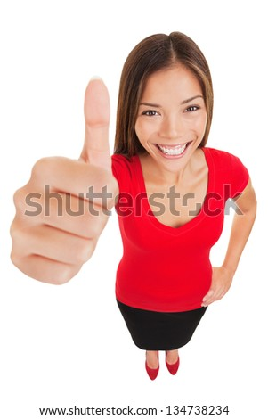 Thumbs up woman. Fun high angle full body portrait of a vivacious laughing woman giving a thumbs up gesture of approval as she looks at camera, isolated on white background. Mixed race businesswoman - stock photo