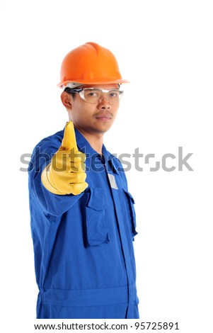Thumbs up worker with a safety helmet , isolated on white - stock photo