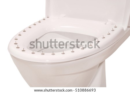 Thumbtacks on the lid of the toilet on white. Clipping path included.