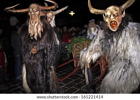 THUMERSBACH, AUSTRIA - DECEMBER 4: Unidentified man wears Krampus (devil) mask at traditional procession on December 4, 2006 in Thumersbach. - stock photo