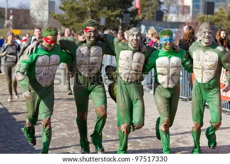 THUN, SWITZERLAND-MARCH 11:Unidentified runners participate in Fisherman's Friend Strongman run in Thun, SUI on March 11, 2012. It consists of 16 km, 43 obstacles and 4,000 runners participated. - stock photo