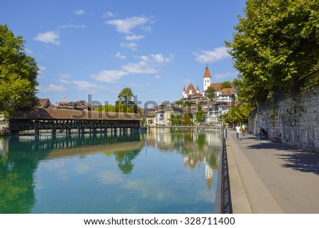 THUN, SWITZERLAND - SEPTEMBER 08, 2015: River Aare and the Old Town of Thun. Thun with a population of approx. 45,000 citizens it is a city located in the canton of Bern, situated on the River Aare - stock photo