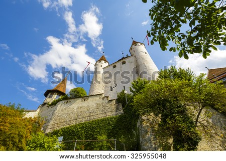 THUN, SWITZERLAND - SEPTEMBER 08, 2015: The famous Castle towering over the castle hill. The castle was built in the 12th century, nowadays it houses the Thun Castle museum - stock photo