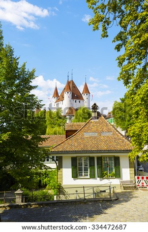 THUN, SWITZERLAND - SEPTEMBER 08, 2015: The famous Castle towering over the city. The castle was built in the 12th century, nowadays it houses the Thun Castle museum
