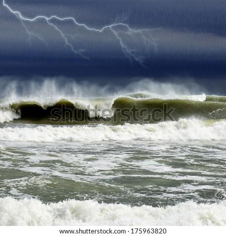 Thunder and rain in sea - stock photo