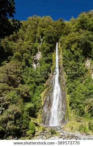 Thunder creek waterfall, Mt Aspiring National Park, Haast Pass, West Coast Region, South Island, New Zealand - stock photo