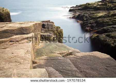 Thunder hole in Acadia National Park at Maine. Use Daylight long exposure for smoothing the waterfall. - stock photo