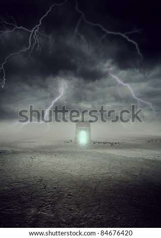 thunder in dead land with a gate giving out light of hope - stock photo
