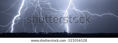 Thunder, lightnings and storm over city at night.