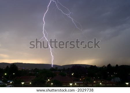 Thunderbolt of lightning at night during a thunderstorm, - stock photo