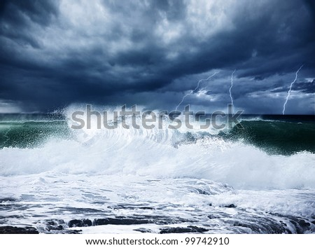 Thunderstorm and lightning on the beach, dark night scene with cloudy rainy stormy landscape, beautiful powerful forces of nature, seascape with high surfing waves, cold dramatic ocean - stock photo