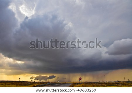 Thunderstorm at the sunset - stock photo