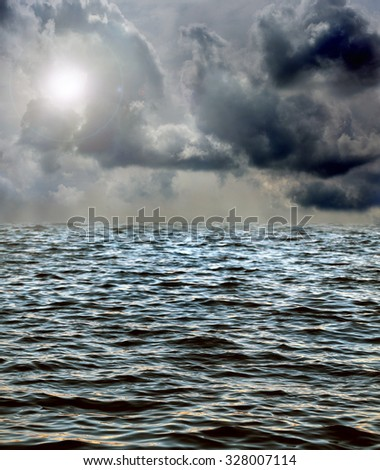 thunderstorm clouds above the sea - stock photo