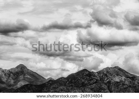Thunderstorm clouds hanging over mountains in Arizona - stock photo