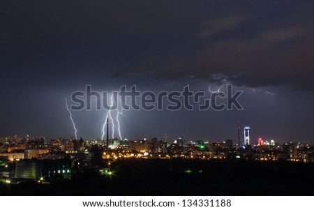 thunderstorm over night city - stock photo