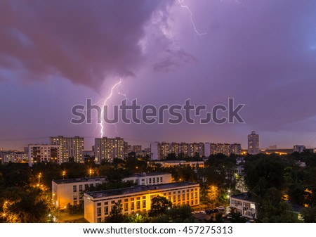 Thunderstorm over the city in the night sky