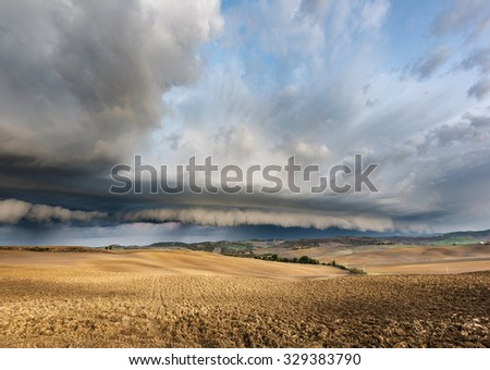 Thunderstorm over the fields in autumn morning