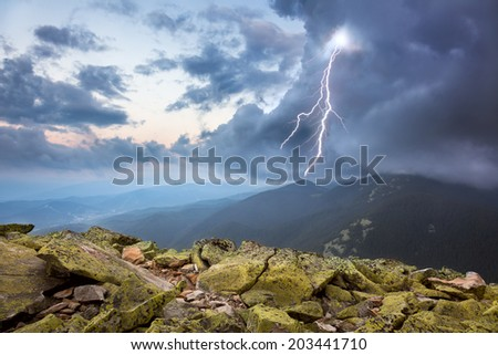 thunderstorm with lightening and dramatic clouds in Carpathian mountains - stock photo