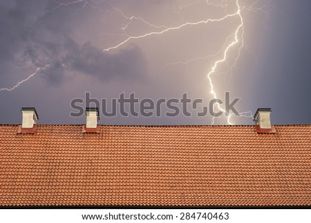 Thunderstorm with lightening, top of the roof at night