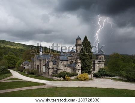 Thunderstorm with lightning in Lowenburg castle or Lion castle near Kassel Germany Europe - stock photo