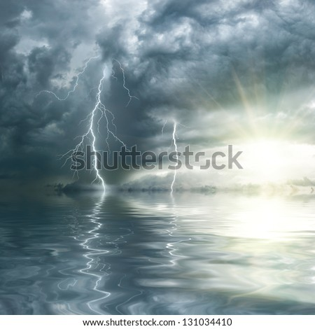 Thunderstorm with rain and lightning over ocean, the sun shines through clouds - stock photo