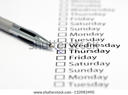 Thursday checked in check box in a row of days of the week - stock photo