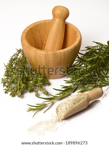 Thyme and rosemary in a mortar on white background