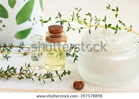 Thyme essential oil and bath salt. Fresh herbal spa.  - stock photo