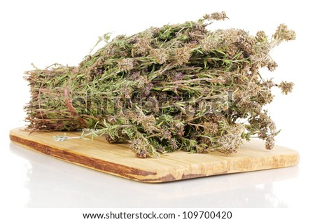 Thyme herb on chopping board isolated on white - stock photo
