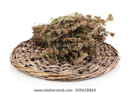 Thyme herb on wicker mat isolated on white - stock photo