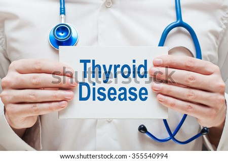 Thyroid Disease card in hands of Medical Doctor - stock photo