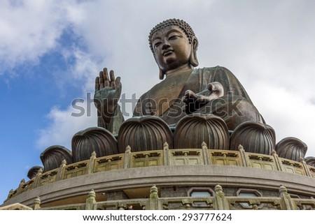 Tian Tan Buddha (the Big Buddha) statue at Ngong Ping, Lantau Island in Hong Kong. - stock photo