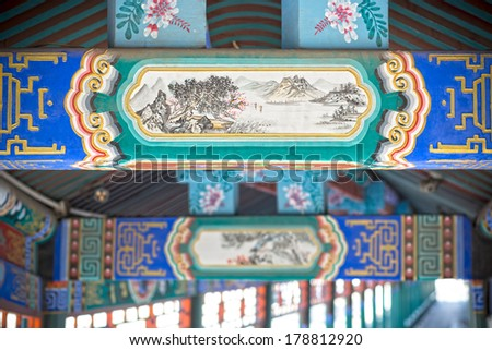 TIANJIN, CHINA - FEBRUARY 3, 2014: Carved beams and painted rafters in traditional chinese porch, located in Beining Park of Tianjin City. FEBRUARY 3, 2014 in Tianjin City, China.