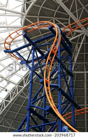 TIANJIN - MAY 17: Large indoor roller coaster orbital, Happy Valley, on May 17, 2014, Tianjin, China.
