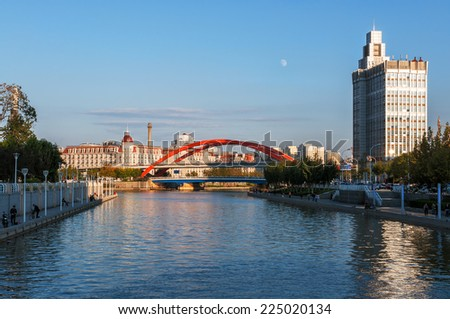 TIANJIN- OCTOBER 5. Tianjin Jingang bridge more beautiful at sunset on both sides of the Haihe River.October 5.2014