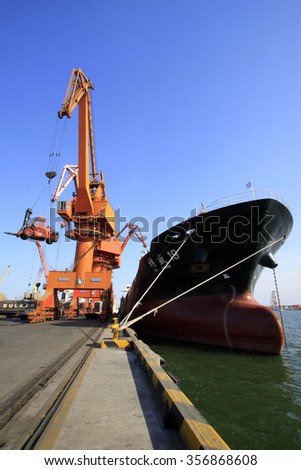 TIANJIN PORT - MARCH 22: Freight terminal and cargo ship, on March 22, 2015, tianjin port, tianjin, China.