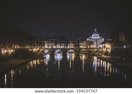 Tiber River and St. Peter's Basilica at night