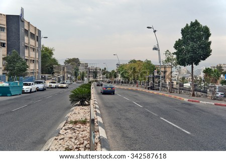 Tiberias, Israel - December 2, 2013: The City of Tiberias life on the streets: people, cars on the streets, the old and new buildings
