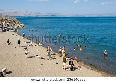 TIBERIAS, ISRAEL - OCT 03, 2014: People are swimming in the sea of Galilee just south of Tiberias - stock photo