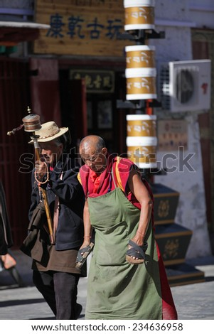 TIBET,CHINA - Aug 16,2013:Prayer on the street at tibet,china.