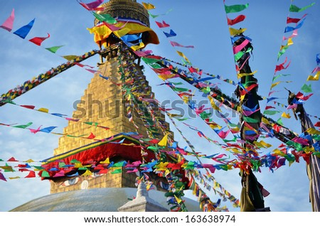 Tibetan Boudhanath temple with prayer flags in Kathmandu, Nepal on a sunny day