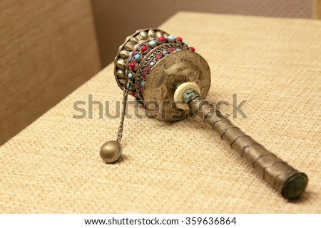 Tibetan Buddhism supplies - handheld prayer wheel, closeup of photo