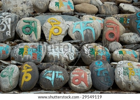 Tibetan colorful prayer stones with letters. Nepal. - stock photo