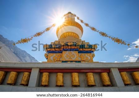 tibetan gompa in sunbeam light - stock photo