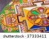 Tibetan mandala tilt from coloured sand - stock photo