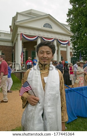 Tibetan New American citizens at Independence Day Naturalization Ceremony on July 4, 2005 at Thomas Jefferson's home, Monticello, Charlottesville, Virginia. - stock photo