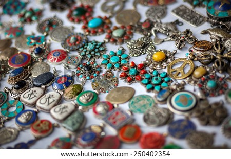 Tibetan pendulums with sacred symbols in the shop in Nepal    - stock photo
