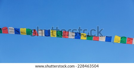 Tibetan prayer flags blowing in the wind - stock photo