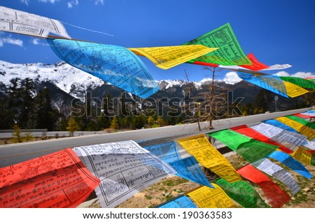 Tibetan Prayer Flags on Snow Mountain