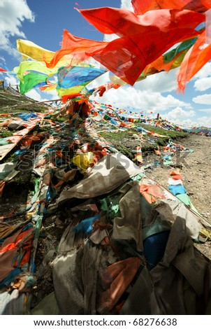 Tibetan Prayer flags tied to a stupa high in the Himalayas, China - stock photo